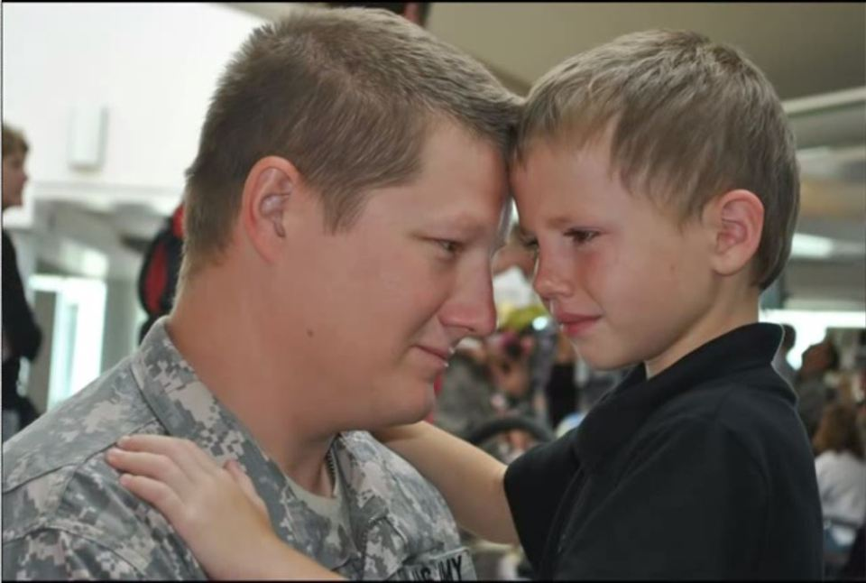 a_deploying_soldier_says_goodbye_to_his_son